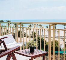 Tumbonas balcón playa